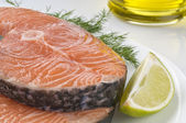 Raw salmon steak with herbs — Stock Photo