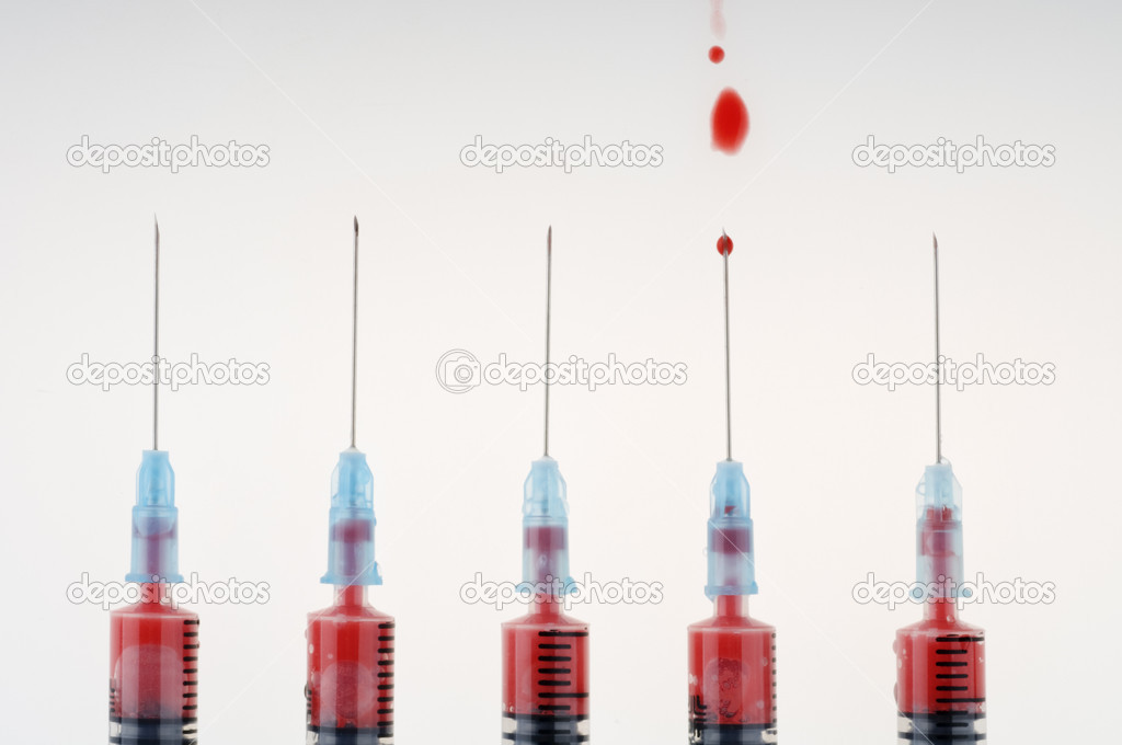 Five syringes with needles and blood drop   Stock Photo #6845892