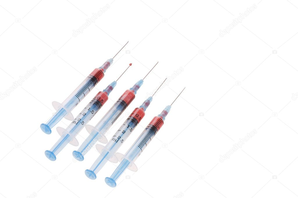 Five syringes with needles and blood drop  isolated on a white background  — Stock Photo #6845905