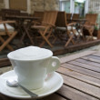 Cappuccino coffee cup outdoor - Stock Photo