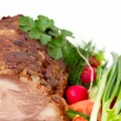 Stock Photo: Chunk of roast meat and fresh vegetables, focus on foreground