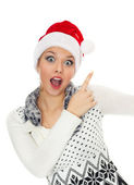 Christmas surprised girl isolated on white — Stock Photo