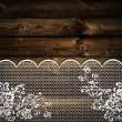 Wooden background with lace — Stock Photo
