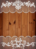 Wooden background with lace frame — Stock Photo
