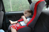 Sweet child asleep in car — Stock Photo