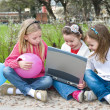 Three girl are playing in the park — Stock Photo