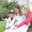 Three sisters in the park — Stock Photo #6868592