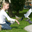 Feeding Pigeons in the park — Stock Photo #6868659