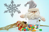 Christmas candy and santa — Stock Photo
