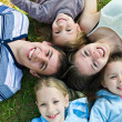 Stock Photo: Young family with beautiful children