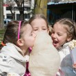Little girls eating candy-floss — Stock Photo