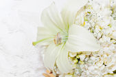 Flowers with Wedding Rings — Stock Photo