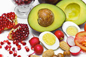 Pome Granate, avocado, egg, radish, nut, tomatoes — Stock Photo
