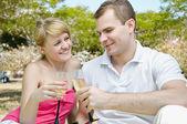 Young couple celebrating — Stock Photo