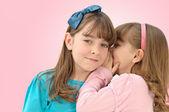 Little girls telling secrets — Stock Photo