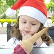 Little girl in Santa's hat — Stock Photo