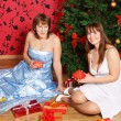 Two young women with gifts — Stock Photo