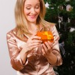 Young  woman opening a present — Stock Photo