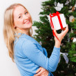 Happy woman with gift-box — Stock Photo
