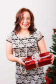 Beutiful woman with Christmas present — Stock Photo