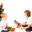 Mother with a son near a new-year tree - Stock Photo