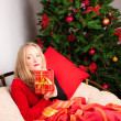 Beautiful woman with a Christmas gift — Stock Photo