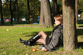 Charming young woman in an autumn park — Stock Photo