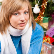 Young woman near a fir-tree — Stockfoto