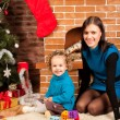 Mother and her daughter near Christmas tree — Stock Photo #7412428
