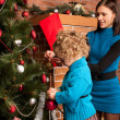 Decorating Christmas tree — Stock Photo #7412466