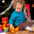 Little girl near Christmas tree — Stock Photo #7412481