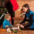 Mother and her daughter near Christmas tree — Stockfoto