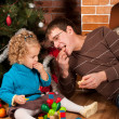 Stock Photo: Dad and his daughter near Christmas tree