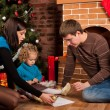 Happy family near Christmas tree — Stock Photo #7412554