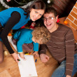Happy family near Christmas tree — Stock Photo #7412563