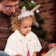 Little girl with her dad near Christmas tree — Stockfoto