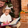 Little girl with her dad near Christmas tree — Foto de Stock