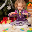 Little girl play near Christmas tree — Stock Photo