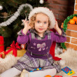 Little girl play near Christmas tree — Stock Photo #7412738