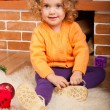 Royalty-Free Stock Photo: Little girl sitting near fireplace