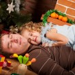 Little girl play with dad near Christmas tree — Stock Photo #7412829