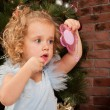 Stock Photo: Little blonde girl with lipstick and mirror