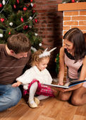 Happy family near Christmas tree — Stock Photo