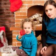 Mother and her daughter near Christmas tree — Stock Photo #7792785