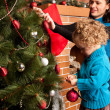 Decorating Christmas tree — Stock Photo #7792794