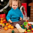 Little girl near Christmas tree — Stock Photo #7792805