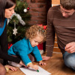 Happy family near Christmas tree — Stock Photo #7792817