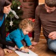 Stock Photo: Happy family near Christmas tree