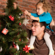Decorating Christmas tree — Stock Photo