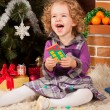 Little girl play near Christmas tree — Stock Photo #7792883